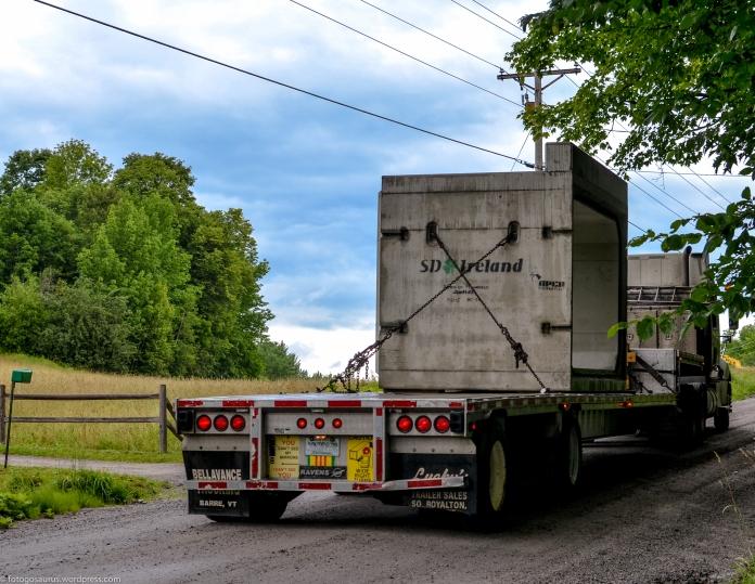lower road culvert - trucks carrying new culvert