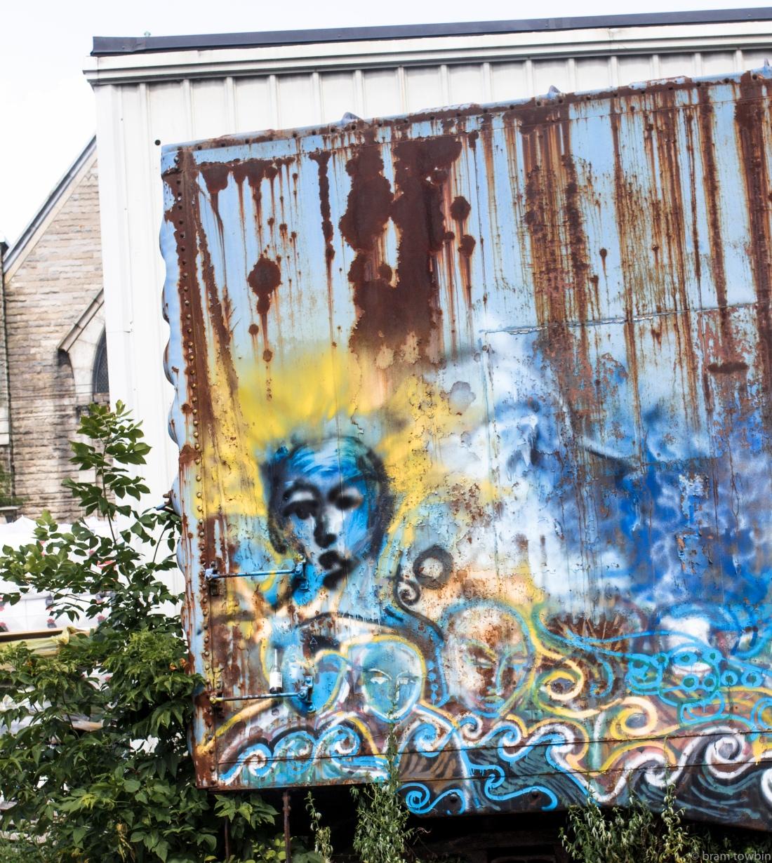 blue person graffitti on train car.jpg