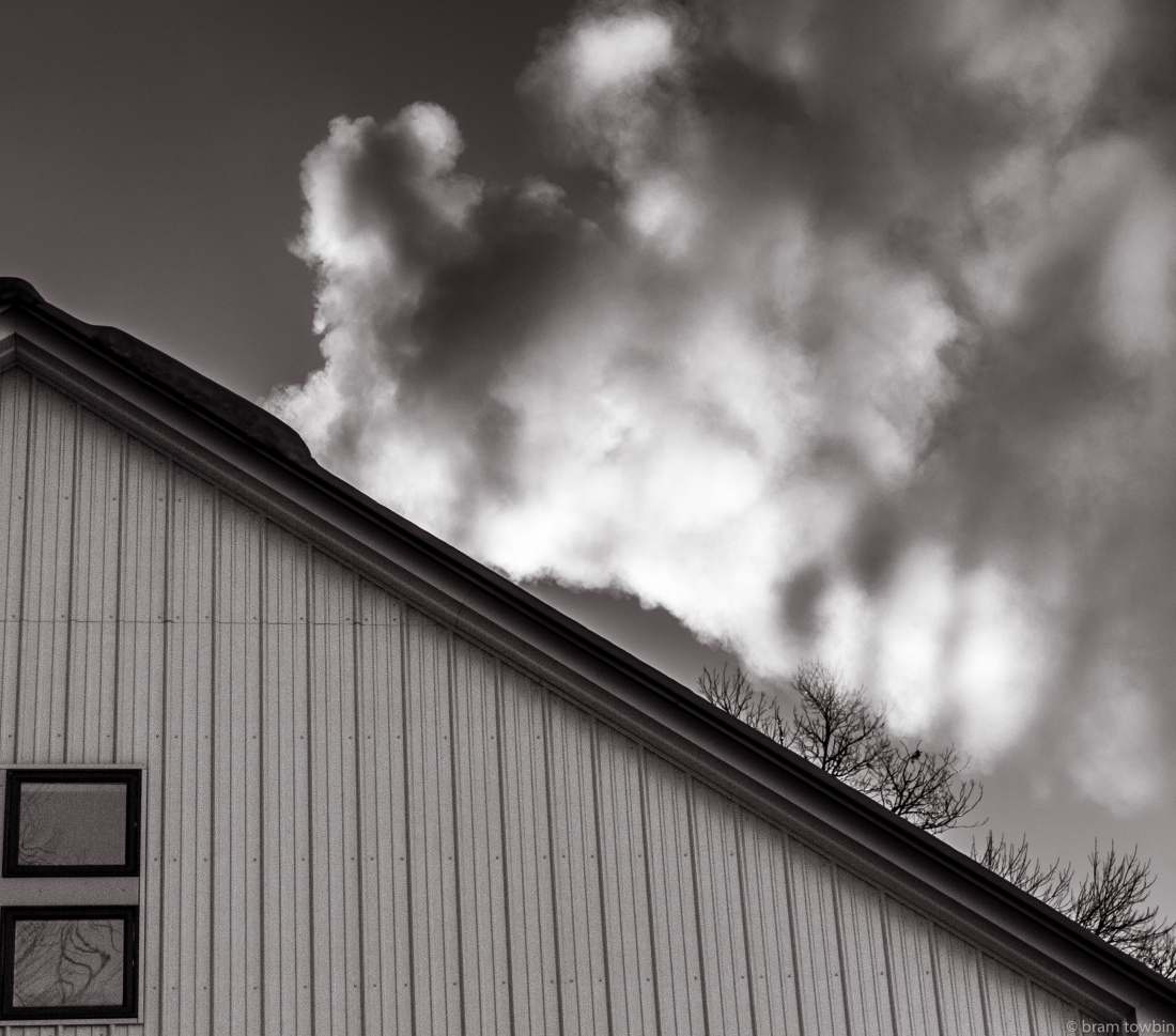 bw chimney smoke over house during cold spell.jpg