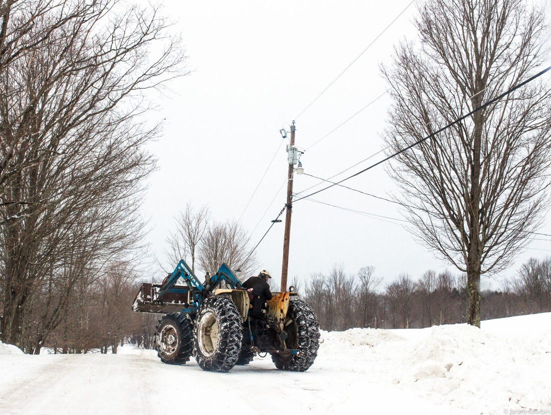 farmer in road winter snow Marshfield.jpg