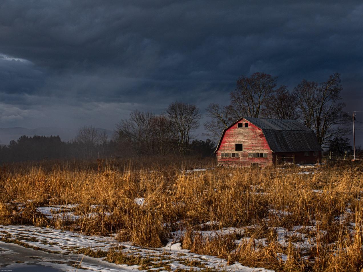 red barn dark clouds